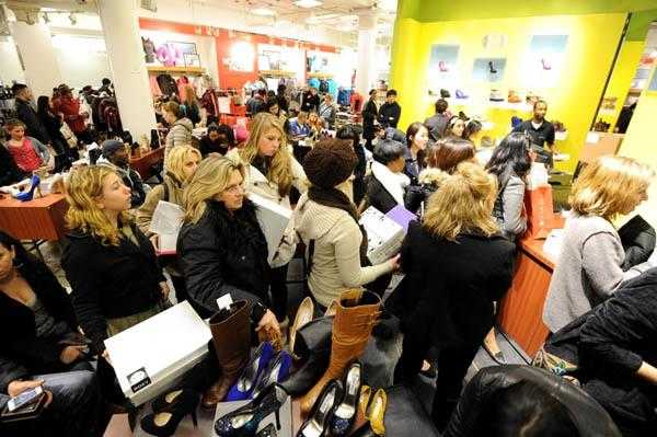 People stand in line to make purchases i
