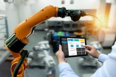 Engineer-hand-using-tablet-heavy-automation-robot-arm-machine-in-smart-factory-industrial-with-tablet-real-time-monitoring-system-application.-Industry-4th-iot-concept.-803972362_1304x808-1024x634.jpeg