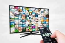 widescreen-high-definition-tv-screen-with-video-gallery-remote-control-in-hand.jpg